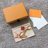 Wholesale Exquisite four leaf flower letter luxury keychain multi pendant bag charm fashion key chain