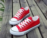 precios de zapatos de diseñador al por mayor-Zapatos de lona zapatillas de deporte Mujeres Hombres Estilo bajo de moda de lujo Clásico diseñador de zapatos Zapatos de lona ocasionales a estrenar precio promocional de fábrica
