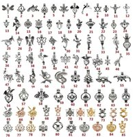 ingrosso hollow locket pendant-Misto 110 stili ciondolo gabbia di perle moda cavità animale aromaterapia olio essenziale diffusore pendente medaglione supporti per fare gioielli