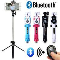 monopod telefon tutucu bluetooth toptan satış-Yeni Taşınabilir Uzatılabilir El Bluetooth Uzaktan Deklanşör Özçekim Telefon Sopa Tripod Monopod Uzaktan Kumanda Standı Tutucu