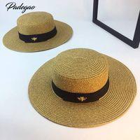 sombrero de paja de oro de las señoras al por mayor-Primavera y verano nuevo retro dorado trenzado cabeza plana sombrero de paja dama amplia aleros protector solar sombrero de verano gorra de sombrero