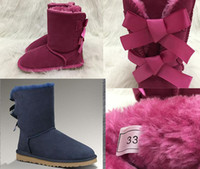 winterstiefel schneespitze großhandel-HOT Australia Schneeschuhe Girls Style Kids Netter Knopf Wasserdichte Slip-On Kinder Winter Kuh Lederstiefel Luxus Designer Schuhe EUR 21-35