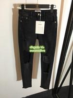 jeans para niñas de alta calidad al por mayor-19 Mujeres de gama alta marca Vintage Jeans delgados con agujero pantalón flaco Girls de alta calidad del pantalón de mezclilla Fit Zipper Fly pantalones largos