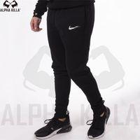 calças de lã padronizadas venda por atacado-Novos homens corredores marca calças masculinas moda calça casual sweatpants homens ginásio muscular algodão treino de fitness hip hop calças elásticas