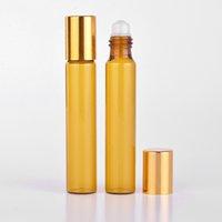 bouteilles d'huile de parfum achat en gros de-En gros 100 pièces / lot 10 ml portable bouteille de parfum rechargeable en verre ambré avec rouleau sur la caisse vide d'huiles essentielles pour le voyageur
