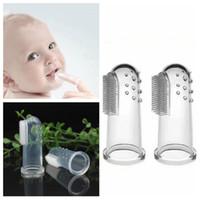 escova macia do dedo do bebê venda por atacado-Ne moda Super macio pet silicone dedo escova de dentes cão de pelúcia escova de dentes cuidados com o bebê escova de dentes limpador oral T2G5050