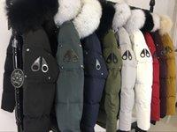 hombres de chaqueta de cuello de piel negro al por mayor-libre de marca de compras clásico caliente Hombres Mujeres invierno gruesa por la chaqueta con capucha y negro para hombre collar de piel de zorro canadiense abajo parkas capa