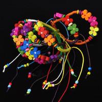braceletes de corda para mulheres venda por atacado-Moda Corda Colorida Artesanal Trançado Cordão De Flor De Madeira Amizade Pulseiras 10 Cores Mulheres Jóias Tamanho Ajustável