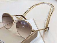 sonnenbrille kette groihandel-Großhandel 2184 gold grau schattiert sonnenbrille kette halskette sonnenbrille frauen modedesigner sonnenbrille gafas neu mit box