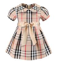 baby beautiful clothes style 도매-격자 무늬 드레스 2019 유럽과 미국 스타일의 새로운 여자 아이 여름 귀여운 인형 칼라 짧은 소매 여자의 고품질 면화 격자 무늬 드레스