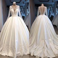 Wholesale silver wedding dress pearl buttons resale online - 2019 White Sheer A Line Pearls Crystal Wedding Dresses V Neck Illusion Long Sleeves Plus Size Bridal Wedding Gowns BC1081