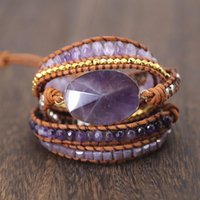 braceletes roxos venda por atacado-Vintage boho bohemia natural pulseiras de cristal roxo envoltório artesanal de couro de ametista grânulos de prata tecido pulseiras jóias mulheres