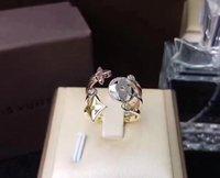 folha de ouro china venda por atacado-2019 Atacado Famosa Marca Anéis Carta V Tamanho Livre 1 set / 3 pcs Aço Inoxidável Trevo De Quatro Folhas Banhado A Ouro Anéis Para As Mulheres