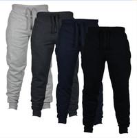 pantalones para niños al por mayor-4 colores Jogger Pants Skinny Men New Fashion Pantalones largos Color sólido Ejecución exterior Pantalones casuales Pantalones niños