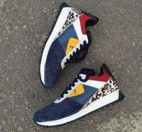 botas de piel mujer venta al por mayor-2018 de calidad superior FD marcas de lujo FUN FUR diseñador zapatillas de deporte de cuero genuino regalo para hombre mujeres Racer venta caliente deportivo botas casuales New38-44