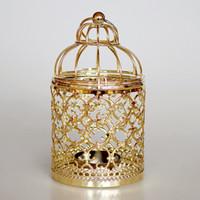 linternas de velas al por mayor-Vintage hierro hueco colgante vela linterna candelabro para el hogar sala de fiesta de bodas Navidad hogar decorativo oro plata