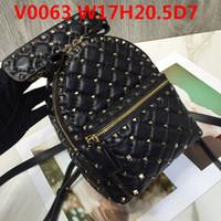 flexibles metall großhandel-Designerin Lederrucksack Imported Luxury Schaffell weiche, flexible Note Top Metallknöpfe Casual Taschen Doppeltaschen