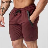 culturismo sexy al por mayor-Pantalones cortos para hombre Pantalones de chándal sexy Gimnasios masculinos Pantalones cortos de fitness Hombres Culturismo profesional Pantalones cortos Pantalones de entrenamiento