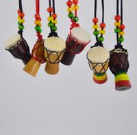 ingrosso strumenti gratuiti-Pendenti africani della catena del maglione dei pendenti di Keychains dei pendenti del tamburo africano della collana dello strumento musicale di legno di Djembe SPEDIZIONE GRATUITA