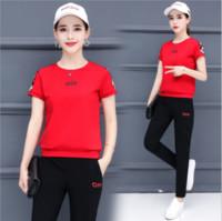 nuevo coreano deportes al por mayor-2019 moda de lujo, ropa deportiva femenina de verano, nueva versión coreana de la moda, camiseta de manga corta, pantalones cortos, conjunto casual de dos piezas