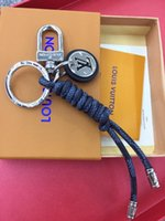 Wholesale braided leather bag resale online - Manual high grade braided rope brand key chain men and women leather car key chain ring leather rope bag stainless steel pendant ad22a