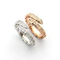 jóias de anéis de cobra venda por atacado-2019 marca de moda homens jóias / mulheres full cz diamond cobra anel casal cor prata anéis de aço de titânio de alta polido amante anéis jewlery