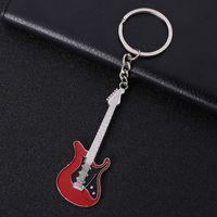 musikinstrumente klingelt großhandel-Gitarre Metall Keychain Schlüsselanhänger - 6 Farben Mini Classic Guitar Schlüsselanhänger Ring Musikinstrumente Womens Bag Charm Geschenk