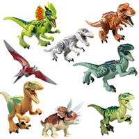 juguete dinosaurio tiranosaurio rex al por mayor-Parque Jurásico Dinosaurio figuras bloques Velociraptor Tyrannosaurus Rex Bloques de construcción de juguete Ladrillos niños colección regalo favor de la fiesta FFA2077