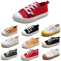 zapatos de lona de los niños de color naranja al por mayor-Zapatos de lona para niños Descuento Niños Niñas Niño de deslizamiento en la galleta de los zapatos ocasionales de Whtie Negro Naranja Rojo Verde colores del caramelo 20-31 Estilo 1