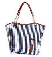 amerikan stili poşetler toptan satış-Sıcak stil tek omuz çantası 2019 yeni tuval püskül çizgili bayan çanta özel fiyat Avrupa ve Amerikan tote çanta