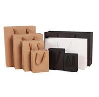 sac cadeau pack papier achat en gros de-Kraft Papier Cadeau Sacs pour Mariage Fête D'anniversaire Cadeau De Noël Cadeau Blanc Sacs D'emballage avec Poignées Sac D'emballage écologique