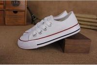 children s sports shoes size al por mayor-Zapatos de lona de los niños de alta moda y baja Calzado deportivo Los niños y niñas Deportes lona cómodos zapatos transpirables Tamaño 23-34