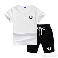 ingrosso vestiti da jogging-U Designer Logo di lusso delle ragazze dei neonati vestiti Set Top manica corta Pant 2 pezzi Outfits bambini Bebes abbigliamento per bambini Tute da jogging