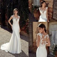 Wholesale design wedding dresses resale online - New Design Mermaid Wedding Dresses Sheer Neck Illusion Lace Appliques Cap Sleeves Floor Length Button Back Plus Size Formal Bridal Gowns