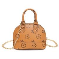 çocuklar kız tasarımcısı çanta toptan satış-Çocuklar Çanta Kore Moda baskı Tasarımcısı bebek Çanta Genç Kızlar Mini Messenger Çanta Çocuk PU Omuz Çantaları 4 renkler