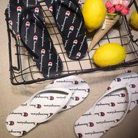 zapatos de agua unisex al por mayor-Mujeres Hombres Carta Sandalias de Verano Unisex Zapatillas Chanclas Deslizarse en la moda Sandalias Playa Agua Mulas Zapatos AAA2230