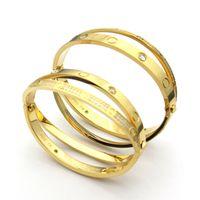ingrosso braccialetto di disegno dei monili per gli uomini-Classici bracciali d'amore di design di lusso Acciaio di titanio Braccialetti trapano pieno per donna Uomo Giravite a vite Coppia gioielli con borsa
