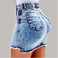 jeans rotos para mujer al por mayor-Sexy borla de cintura alta falda de mezclilla mujeres caderas empuja hacia arriba Distressed Mini falda lápiz 2019 damas arrancó verano vintage jeans