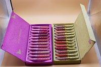 ingrosso purple lipstick-in magazzino Kit di rossetti liquidi opachi a 12 colori caldi Cosmetici 12pcs / set Set di lucidi per labbra viola e oro