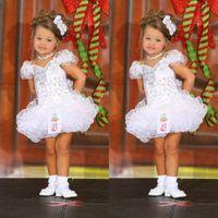 vestido de menina de flor ritzee branco venda por atacado-Girl's Pageant Vestidos Com Decote Em V Mangas Capuz De Cristal Frisado Branco Vestidos De Baile Organza Tubulação Em Camadas 2019 Vestidos Das Meninas De Flor