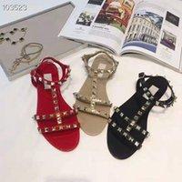 waren importieren großhandel-Luxusschuhe Importierte Lederwaren Stoff Nietelemente Dekoration Sexy glamouröse flache Sandalen für Damen Strandschuhe