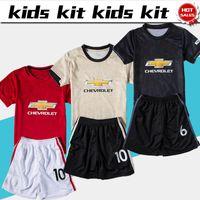 traje marcial al por mayor-2.020 niños Kit United en casa # 6 Pogba # 9 camisetas de fútbol MARCIALES Traje 19/20 fútbol infantil de fútbol ausente del tercer camisas uniformes Jersey + shorts