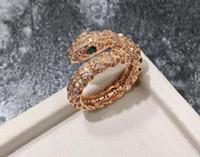 ingrosso testa calda glitter-Prezzo di fabbrica all'ingrosso commercio estero gioielli caldi Europa e America cerchio singolo serpente scala glitter testa di serpente anello aperto tre colori