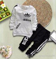 ücretsiz gönderim çocuk t-shirt toptan satış-Erkek kız yonca yaprağı mektuplar Spor takım elbise YENI çocuk 5 Renk Uzun kollu T-shirt + pantolon 2 adet set takım bebek giysileri Ücretsiz kargo