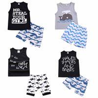 ropa de moda de dibujos animados al por mayor-Conjuntos de ropa para niños Ropa de verano para bebés Bebés de dibujos animados Estampado de tiburones para niños Conjuntos Moda infantil Camiseta Pantalones cortos Trajes de niños C4321