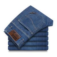знаменитая дизайнерская одежда оптовых-Summer Mens plus size 44 46 48 -clothing Denim Jeans Pants Men Famous Designer Cotton Silm fit Thin Jeans