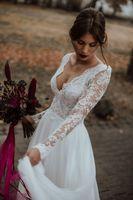 ingrosso beach wedding dresses-Abiti da sposa a-line in pizzo bianco con maniche lunghe 2019 Summer Beach Sexy abito da sposa Plus Size Backless Floor Length