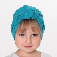 chapéu cloche crianças venda por atacado-Nó do bebê turbante chapéu Stretchy Cloche Cap Turbante Bowknot Cap Infantil Primavera Outono Crianças Chapéus Beanie Acessórios