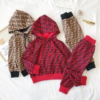 çocuklar moda spor hoodies toptan satış-Perakende çocuklar lüks giysi tasarımcısı kızlar mektup kapüşonlu eşofman 2 adet kıyafetler setleri (hoodies + pantolon) moda Rahat Spor takım elbise butik giyim