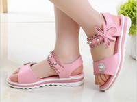 niños coreanos arcos al por mayor-Pearl new pink fashion blanco antideslizante fondo suave Arcos sandalias de diseño verano nuevas chicas coreanas sandalias niños princesa zapatos